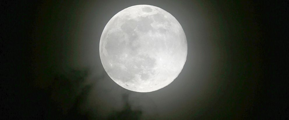 """PHOTO: The moon rises Saturday, July 12, 2014 over metropolitan Manila in the Philippines in one of the three """"Supermoon"""" occurrences for this year."""