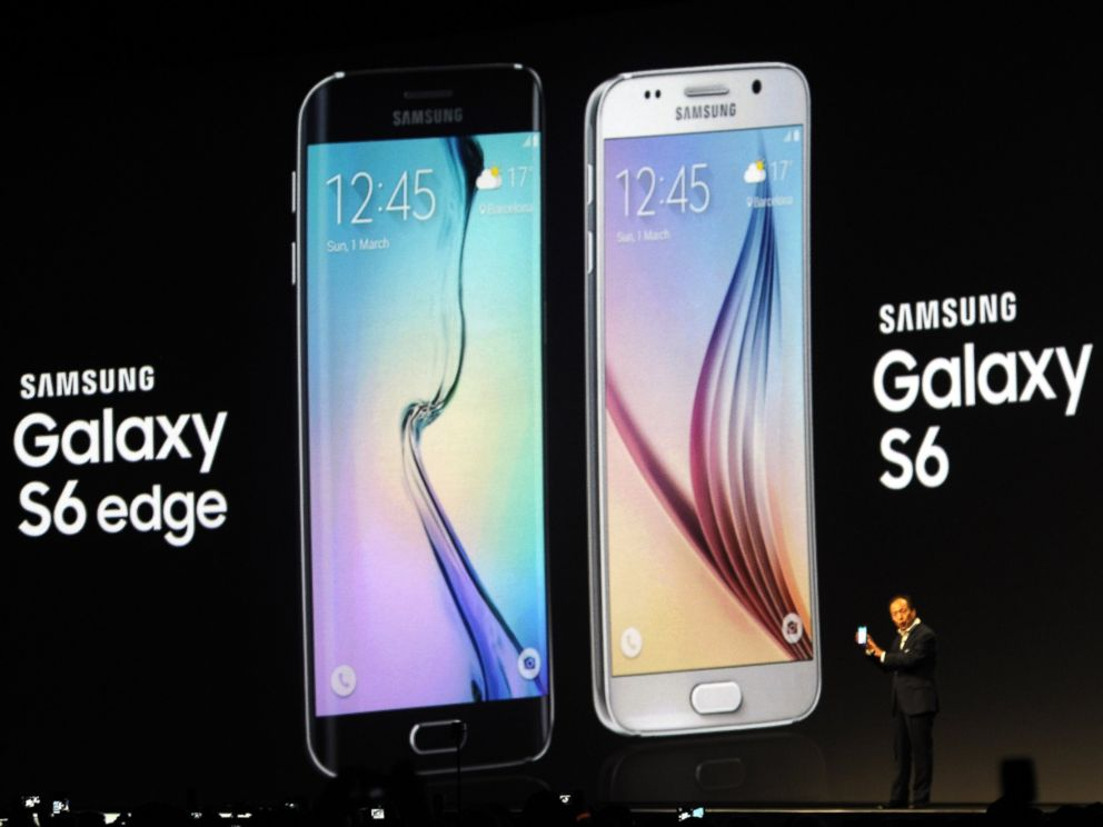 PHOTO: JK Shin, CEO of Samsungs mobile division, shows the new Galaxy S6 and S6 Edge, during a Samsung Galaxy Unpacked 2015 event on the eve of this week?s Mobile World Congress wireless show, in Barcelona, Spain, Sunday, March 1, 2015.