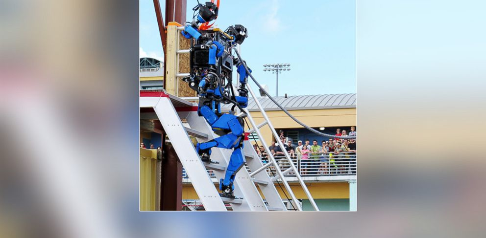 PHOTO: Photo shows Schaft, a humanoid robot developed by Japanese venture company Schaft Inc., at the DARPA Robotics Challenge in Homestead, Fla., Dec. 21, 2013.