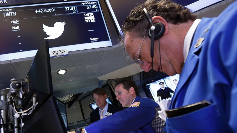 PHOTO: A trader works at the post that handles Twitter on the floor of