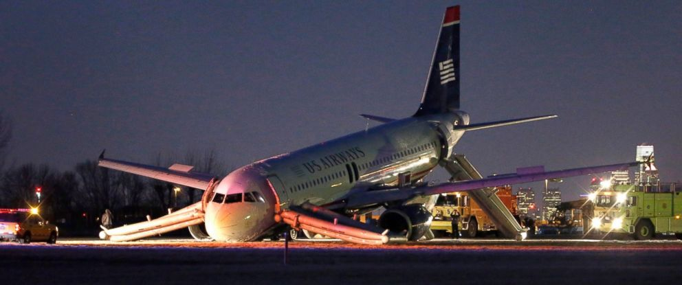 PHOTO: A damaged jet lies at the end of a runway after the pilot aborted takeoff of US Airways Flight 1702 at Philadelphia International Airport in Philadelphia, March 13, 2014.