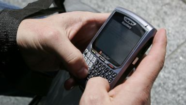 PHOTO: BlackBerry user Douglas Philips checks emails on his BlackBerry, April 18, 2007, in San Francisco.