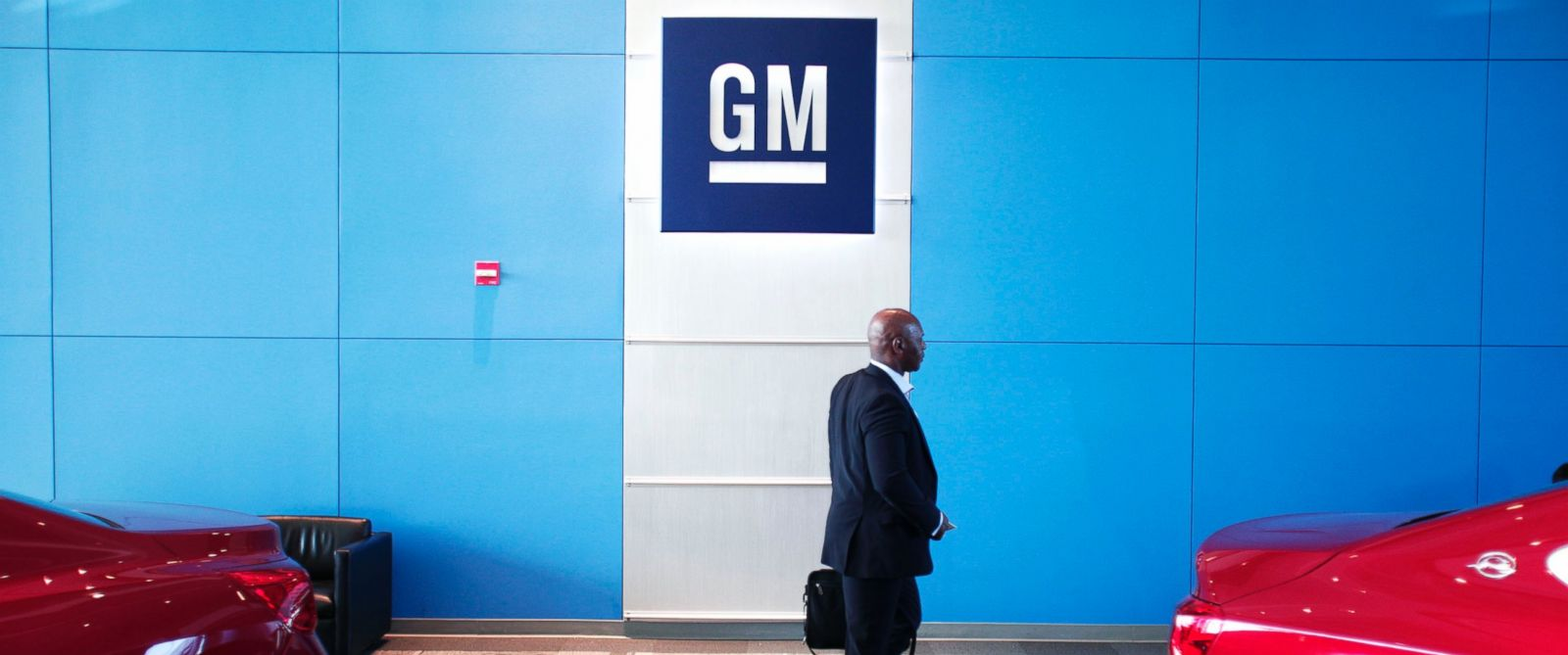 PHOTO: A person walks past the GM logo at the General Motors Technical Center on June 5, 2014 in Warren, Mich.