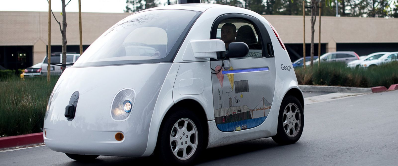PHOTO: A self-driving car traverses a parking lot at Googles headquarters on Jan. 8, 2015 in Mountain View, Calif.