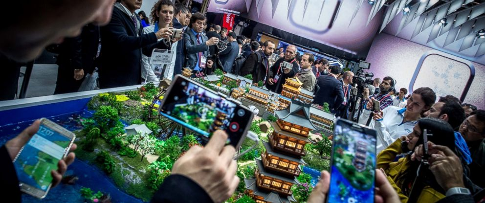 PHOTO: Visitors check new ZTE devices on the opening day of the World Mobile Congress at the Fira Gran Via Complex on Feb. 22, 2016 in Barcelona, Spain.