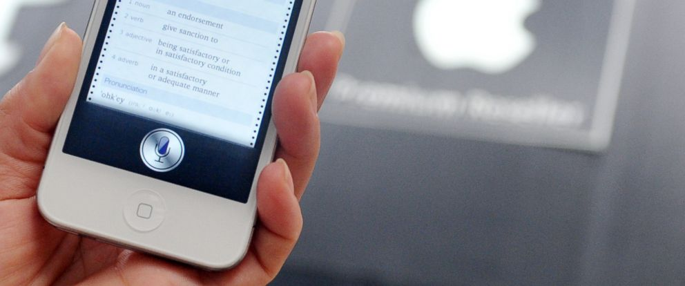 """PHOTO: A woman displays """"Siri,"""" voice-activated assistant technology, on an Apple iPhone 4S in Taipei, July 30, 2012."""