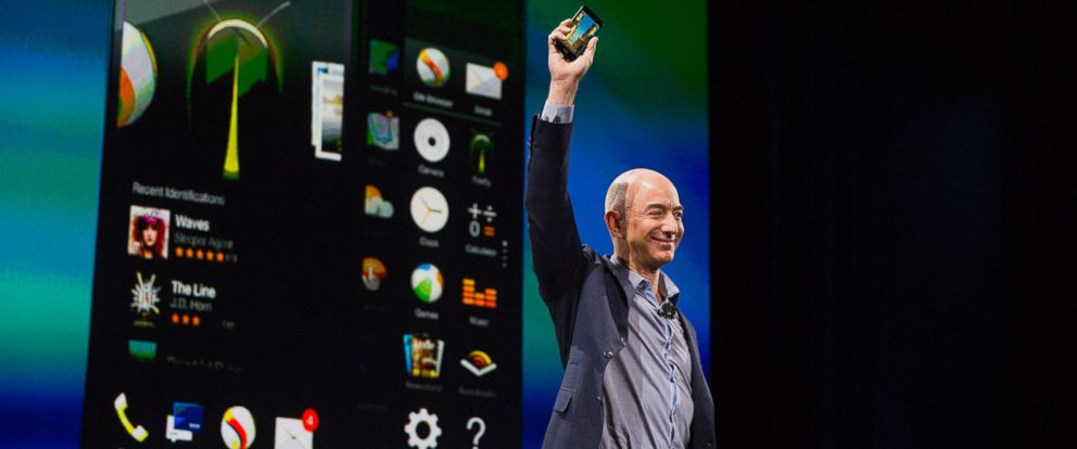 PHOTO: Jeff Bezos, chief executive officer of Amazon.com Inc., unveils the Fire Phone during an event at Fremont Studios in Seattle, Wash. on June 18, 2014.