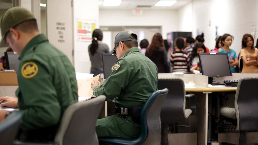 PHOTO: U.S. Customs and Border Protection agents work at a processing facility, June 18, 2014, in Brownsville,Texas.
