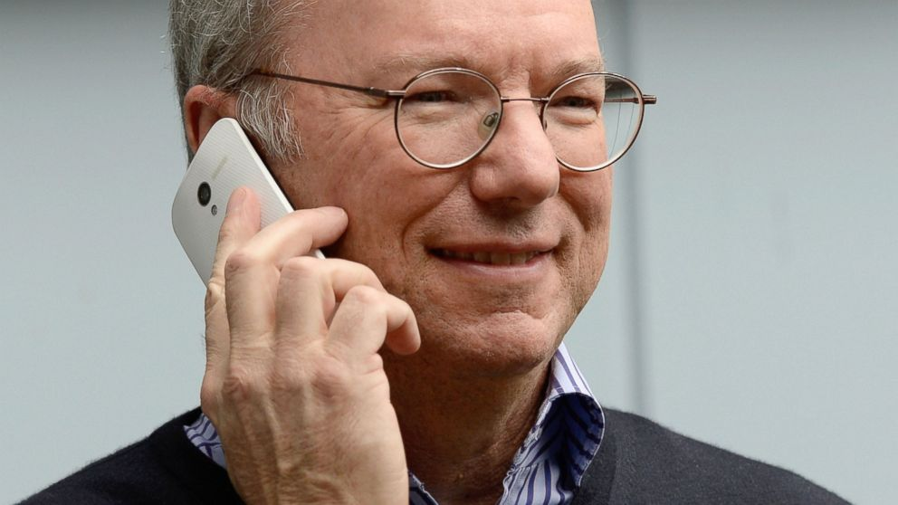 PHOTO: Eric Schmidt, executive chairman of Google, makes a call on a Moto X phone during the Allen & Co. annual conference July 11, 2013, in Sun Valley, Idaho.