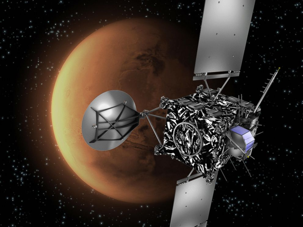PHOTO: This image shows an artists impression of the European Space Agency (ESA) probe Rosetta with Mars in the background.