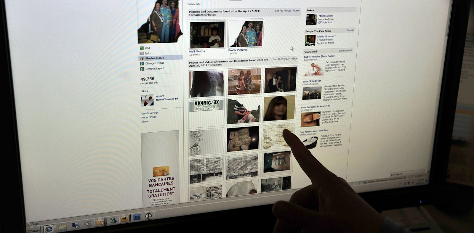 PHOTO: A woman looks at a Facebook page.