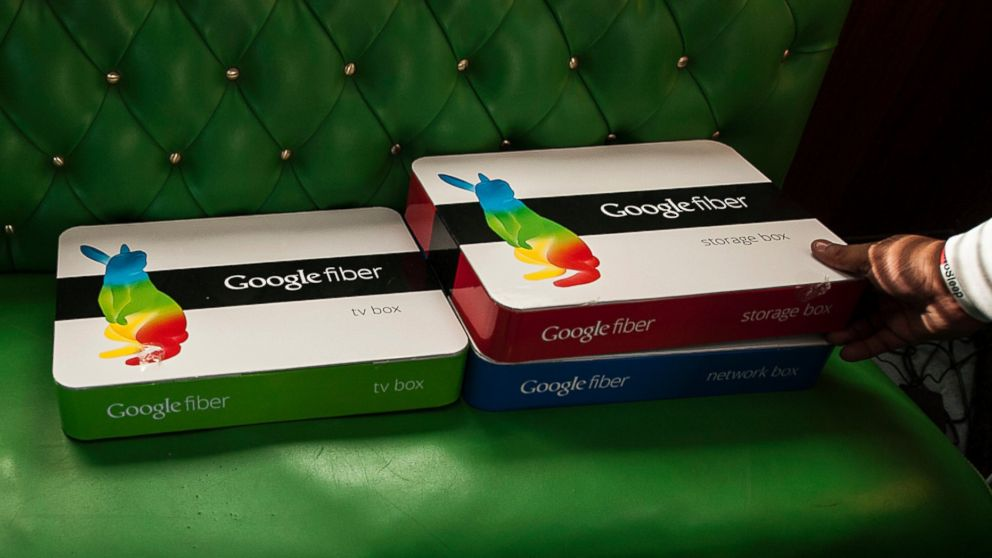 PHOTO: Boxes of equipment needed to install Google Fiber broadband network sit on a couch at the home of customer Becki Sherwood in Kansas City, Kansas, U.S., Nov. 27, 2012.