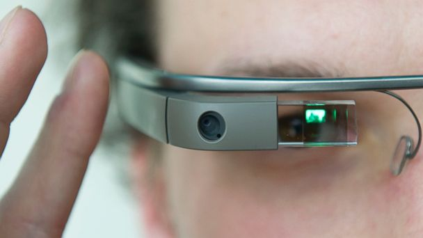 "PHOTO: A visitor of the ""NEXT Berlin"" conference tries out the Google Glass in this April 24, 2013, file photo in Berlin."