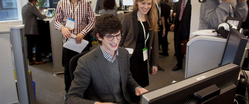 PHOTO: Employees smile while working during a media tour for the grand opening of Google Inc.s new office in Toronto, Nov. 13, 2012.