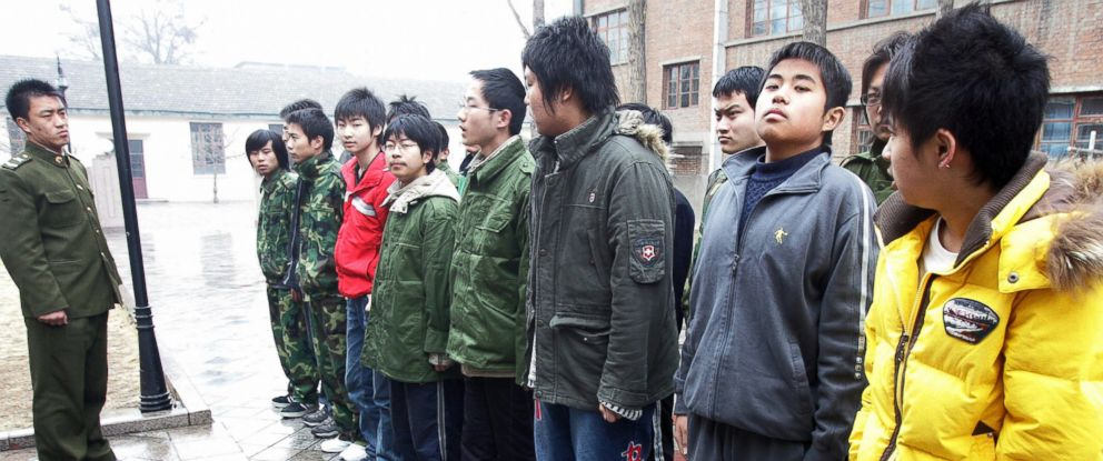 PHOTO: Teenagers assemble at the Internet Addiction Treatment Centre in the southeastern suburb of Daxing, near Beijing, China on March 1, 2007.