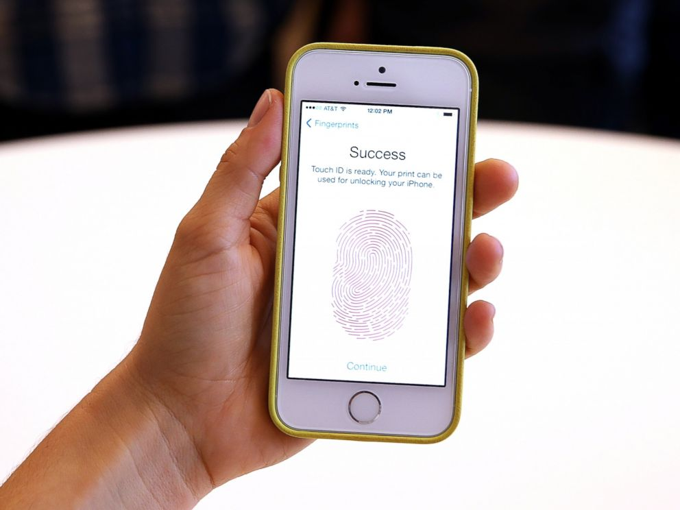 PHOTO: The new iPhone 5S with fingerprint technology is displayed during an Apple product announcement at the Apple campus, Sept. 10, 2013, in Cupertino, Calif.
