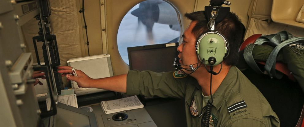 PHOTO: Flight Officer Jack Chen mans the navigation and comms station on board a Royal Australian Air Force AP-3C Orion as they search for debris or wreckage of missing Malaysian Airlines flight MH370, March 22, 2014.