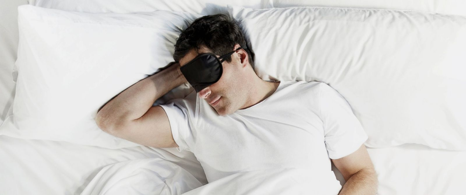 PHOTO: A man sleeps wearing an eye mask in this undated stock photo.