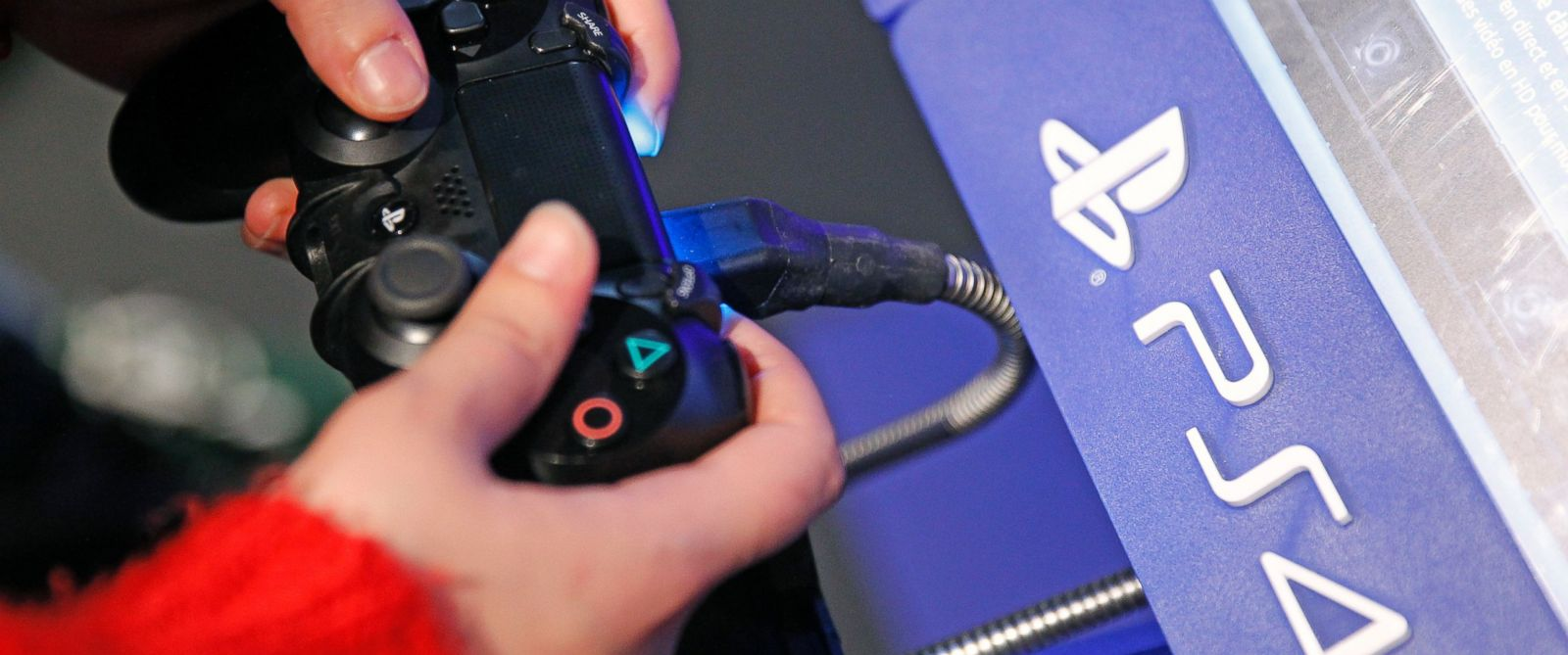 "PHOTO: A visitor plays on Sony Playstation 4 video game console (PS4), produced by Sony Corporation, during the ""Noel de Geek,"" Dec. 23, 2014, in Paris."