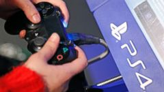 PHOTO: A visitor plays on Sony Playstation 4 video game console (PS4), produced by Sony Corporation during the Noel de Geek, Dec. 23, 2014, in Paris.