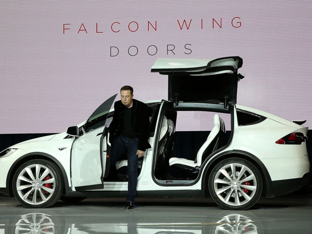 PHOTO: Elon Musk demonstrates the falcon wing doors on the new Tesla Model X Crossover SUV during a launch event on Sep. 29, 2015 in Fremont, California.