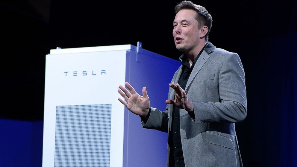 PHOTO: Elon Musk, CEO of Tesla, is pictured with a Powerpack unit at Tesla Design Studio on April 30, 2015 in Hawthorne, Calif.