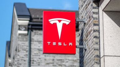 PHOTO: This Nov. 27, 2015 file photo shows the logo of a Tesla Motors store in downtown Hangzhou in the Zhejiang Province of China.