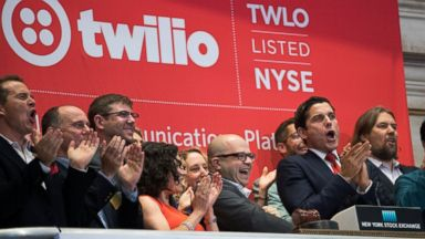 PHOTO: Twilio Inc. founder and CEO Jeff Lawson, center, reacts after ringing the opening bell to celebrate Twilios initial public offering, at the New York Stock Exchange, June 23, 2016 in New York.