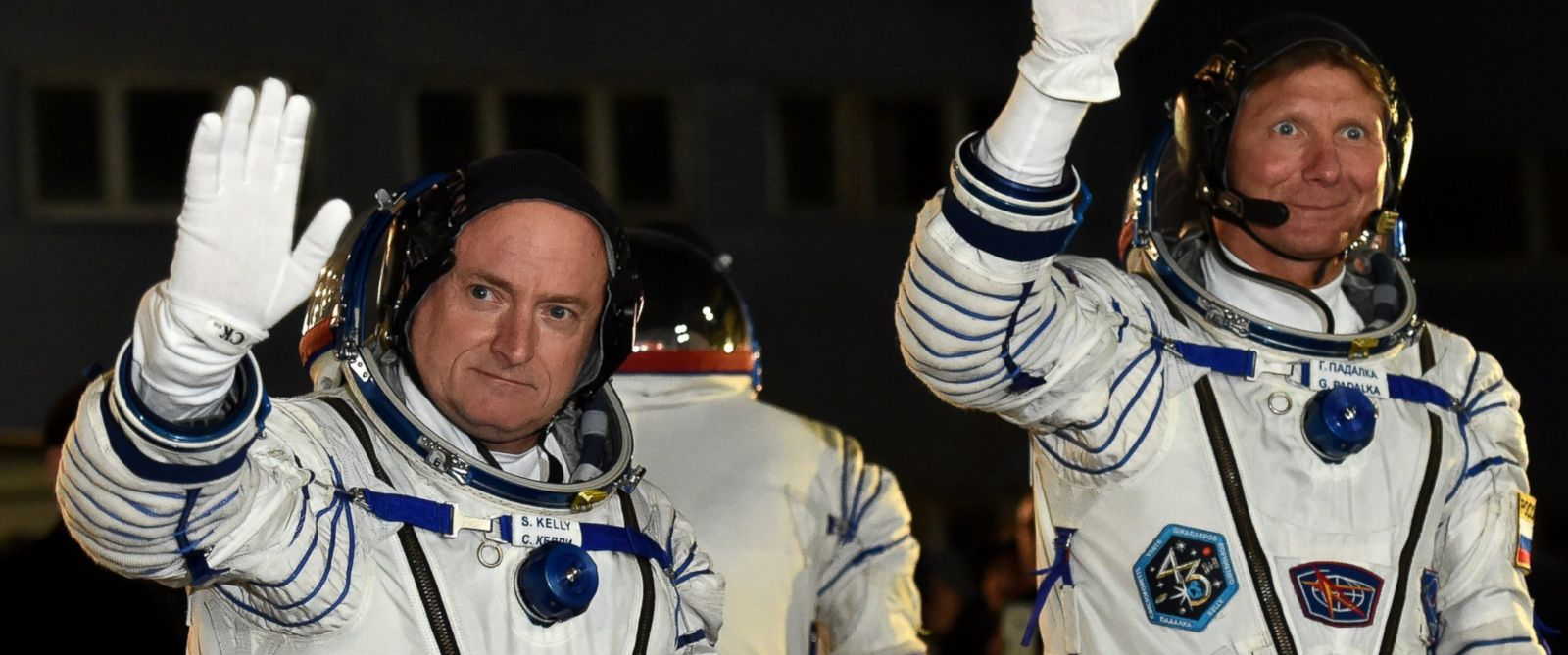 PHOTO: US astronaut Scott Kelly and Russian cosmonaut Gennady Padalka wave after their space suits were tested at the Russian-leased Baikonur cosmodrome, March 27, 2015.