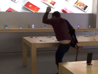 PHOTO: A man apparently upset about customer service he had received used a metal ball to smash several iPhones and a laptop at an Apple Store in Dijon, France.