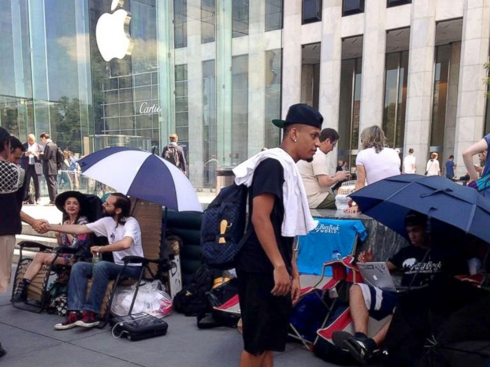 PHOTO: People wait outside of the flagship Apple Store in New York City, hoping to be the first to get their hands on any new electronics Apple may release.