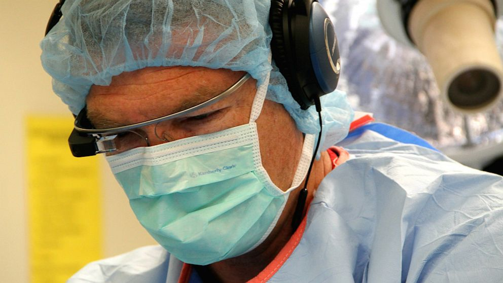 Dr. Christopher Kaeding, an orthopedic surgeon at The Ohio State University Wexner Medical Center is shown wearing Google Glass while performing surgery.