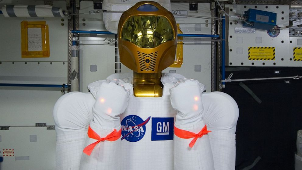 PHOTO: Robonaut is good to go after the power soak. The red ribbon is to remind the crew not to use its arms as handles.