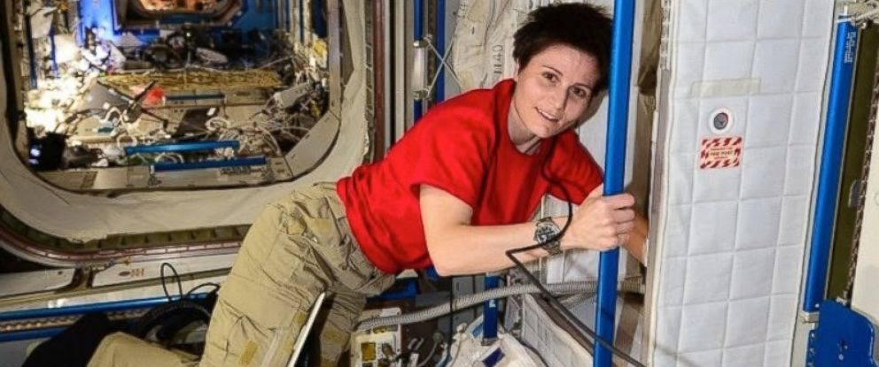 PHOTO: Italian astronaut Samantha Cristoforetti uses a vaccuum at the International Space Station