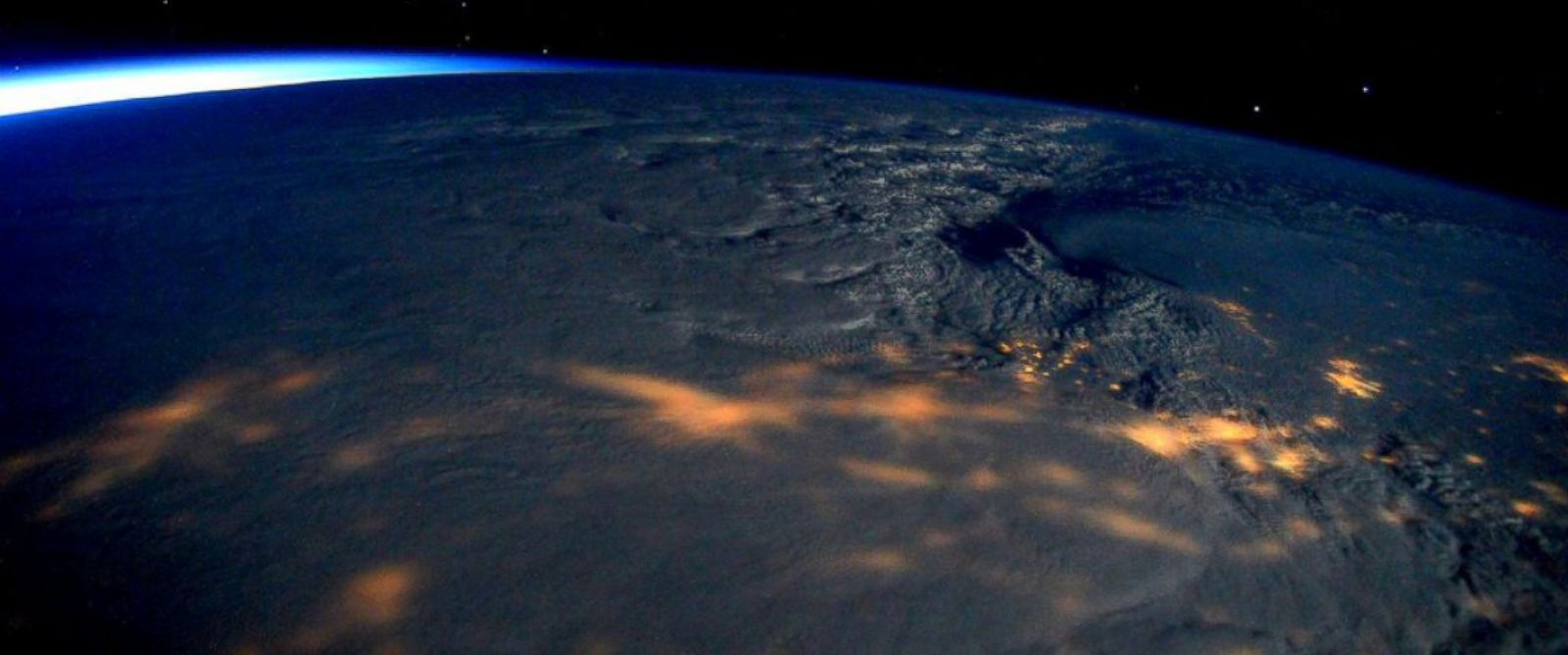 "PHOTO: Scott Kelly posted this photo to Twitter, Jan, 23, 2016 with the caption, ""Massive #snowstorm blanketing #EastCoast clearly visible from @Space_Station! Stay safe!"""