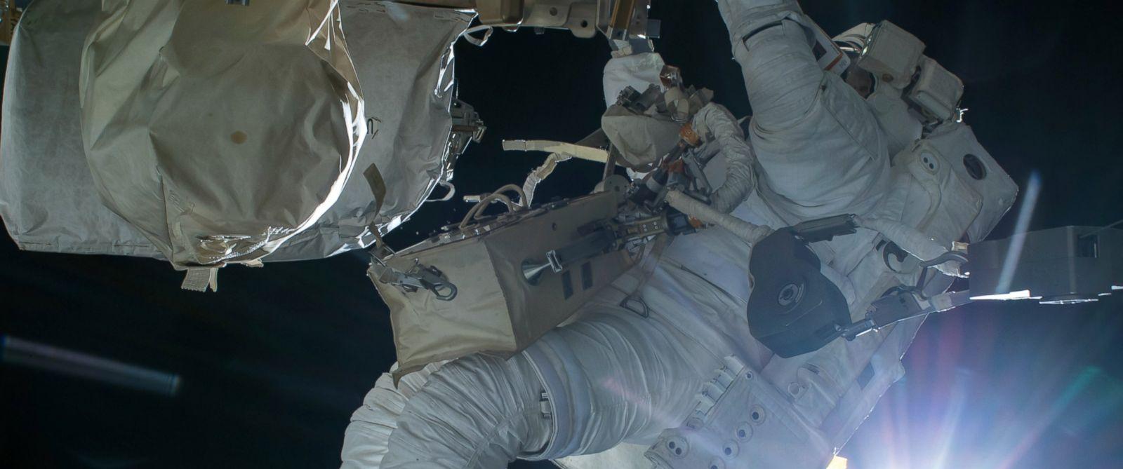 PHOTO: Astronaut Terry Virts conducts a spacewalk during an orbital sunrise on Feb. 21, 2015.