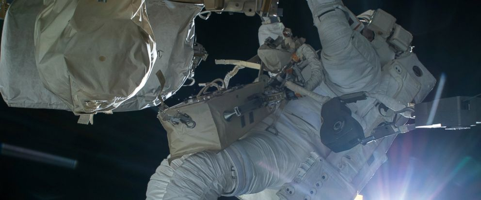 PHOTO: Astronaut Terry Virts conducts a spacewalk during an orbital sunrise on Feb. 21, 2015.