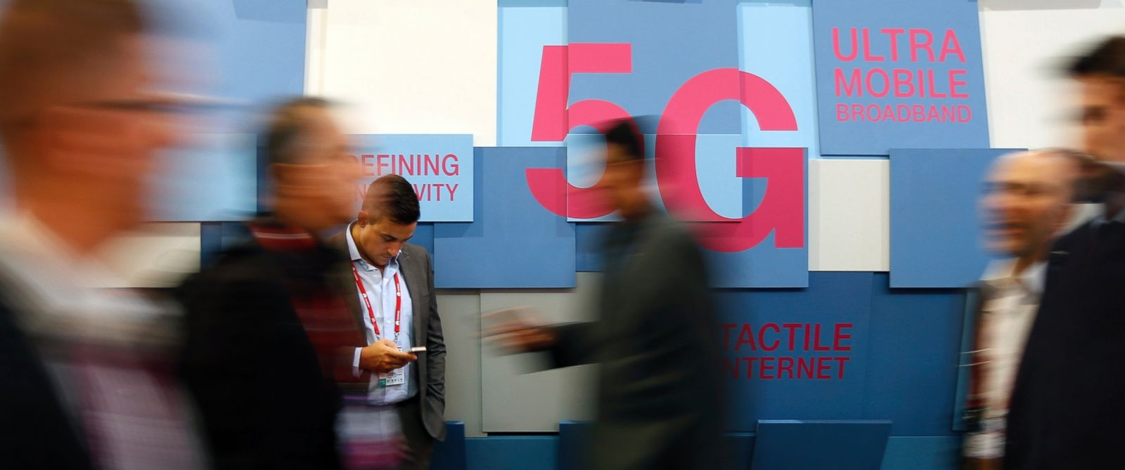 PHOTO:People walk past a 5G banner during the Mobile World Congress in Barcelona, Spain Feb. 23, 2016.
