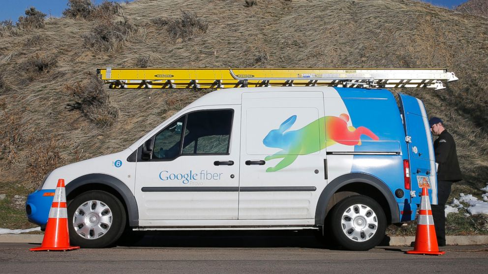 PHOTO: A Google Fiber technician gets supplies out of his truck to install Google Fiber in a residential home in Provo, Utah in this Jan. 2, 2014 file photo.