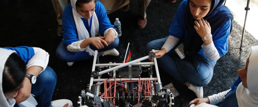 The Afghanistan team fixes their robot in between rounds of the FIRST Global Robotics Challenge, Monday, July 17, 2017, in Washington. The challenge is an international robotics event with teams from over 100 countries. (AP Photo/Jacquelyn Martin)