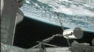 VIDEO: Spacewalking astronauts hook up new chamber to the International Space Station.