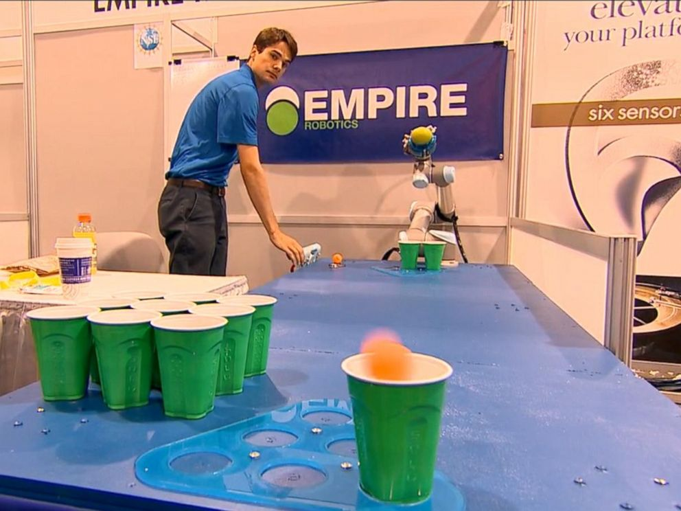 PHOTO: A robot tosses a pingpong ball in a round of beer pong at CES 2015.