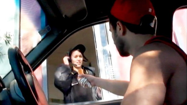 PHOTO: Alki Stevens shocks fast food workers by grabbing ice cream cones from the top known as 'cone-ing'.