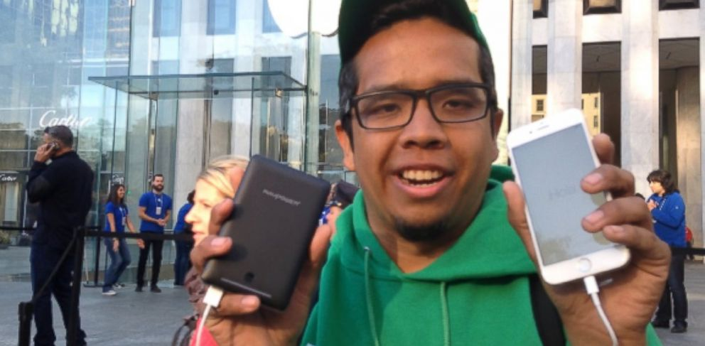 PHOTO: Eduardo Campos was the first person out the door of Apples flagship store in New York City with the new iPhone 6.