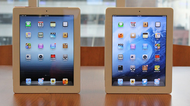 PHOTO: The new iPad and the iPad 2 stand side by side.