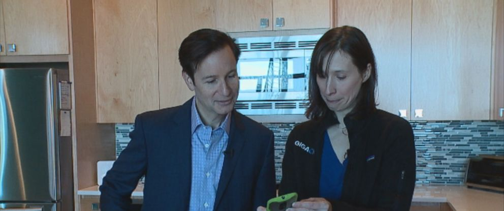Tech writer Stacey Higginbotham (right) shows ABCs Neal Karlinsky (left) how the devices in her home work together.