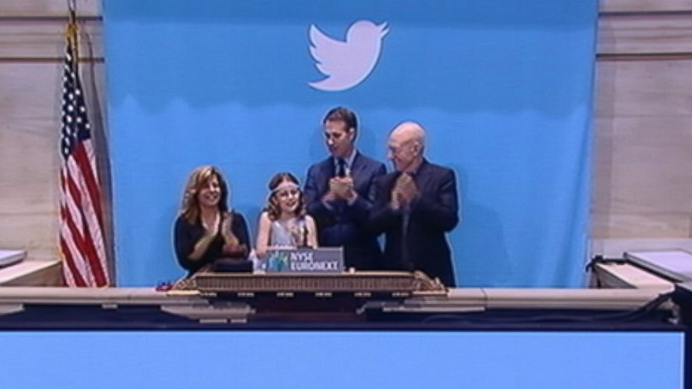 PHOTO: Patrick Stewart, right, 9-year-old lemonade stand owner Vivienne Harr and a representative from the Boston PD were on hand to ring the opening bell on the New York Stock Exchange, Nov. 7, 2013.