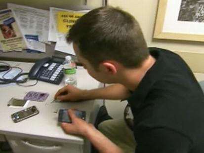 VIDEO: Brendan McElroy is on call to fix NYC residents broken iPhones.