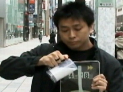 VIDEO: A Japanese street performer develops a series of magic tricks involving the iPad.