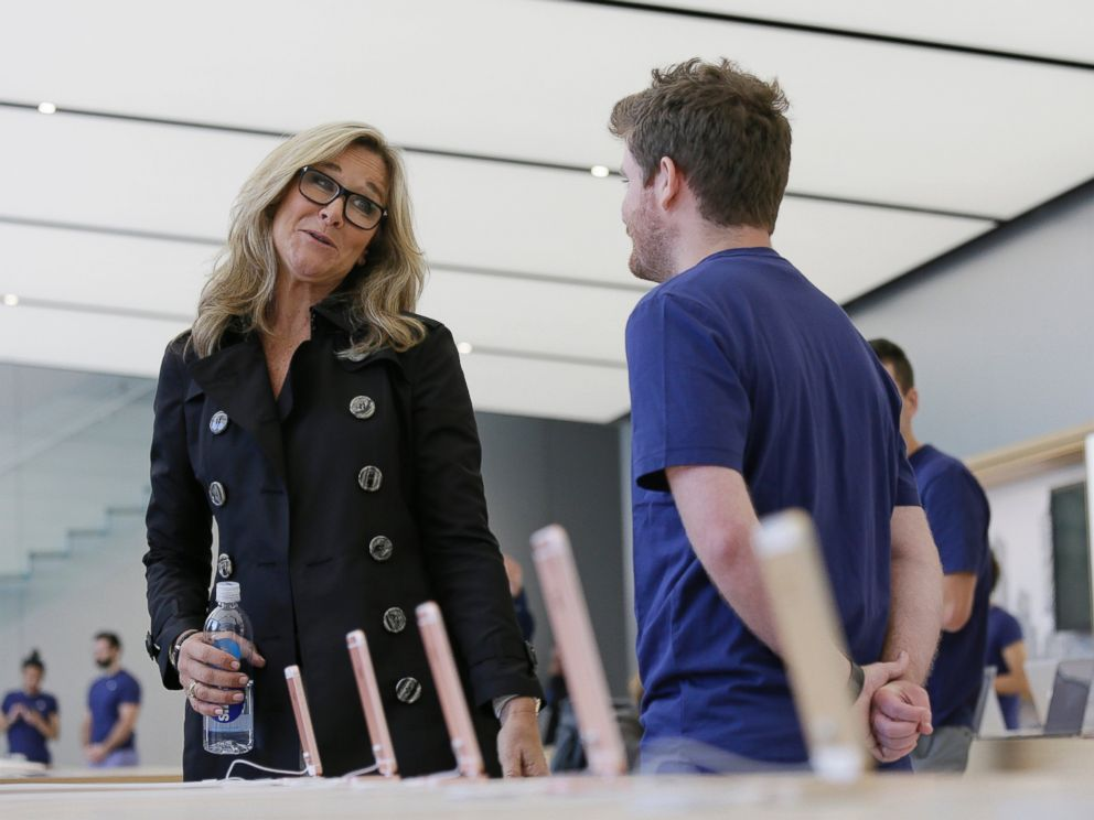Angela Ahrendts, Apples senior vice president of retail and online stores, speaks with an employee during a preview of the new Apple Union Square store, Thursday, May 19, 2016, in San Francisco.
